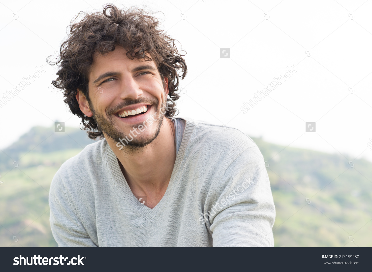 stock-photo-portrait-of-young-handsome-man-smiling-outdoor-213159280